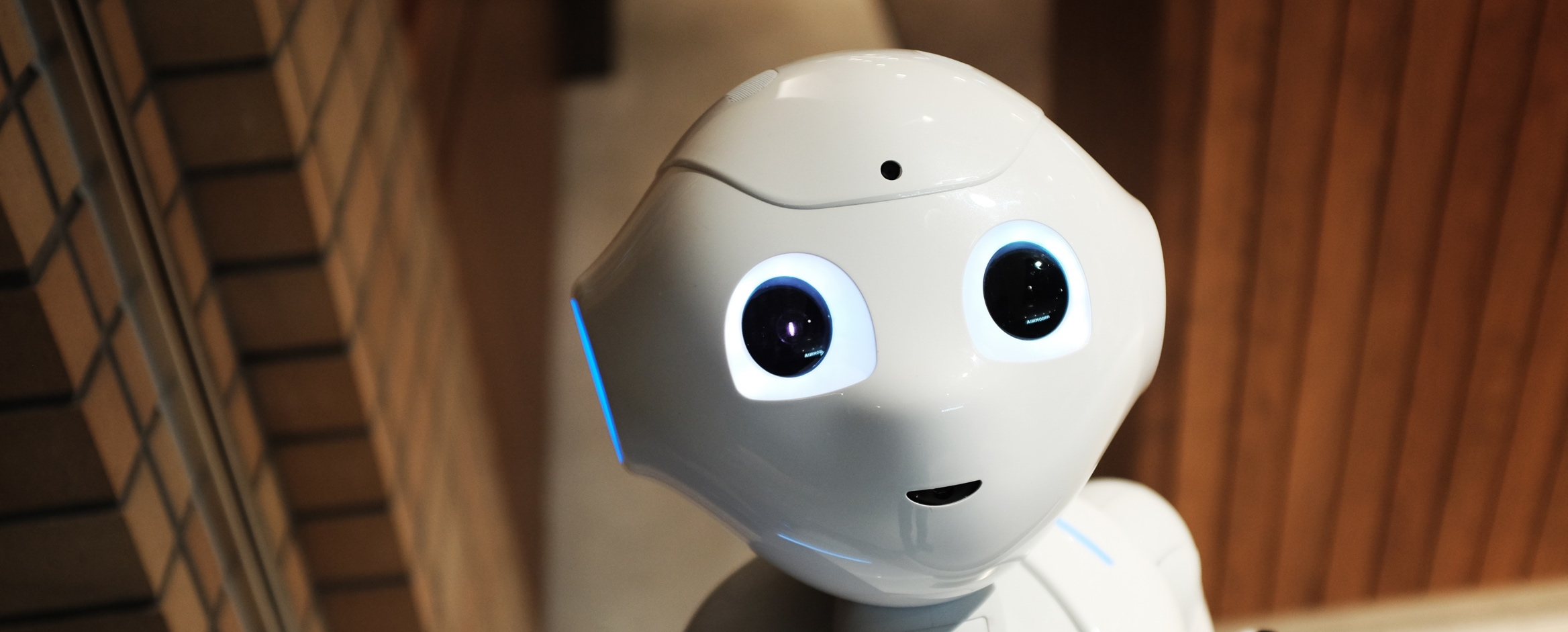 A human-like robot looks up at you