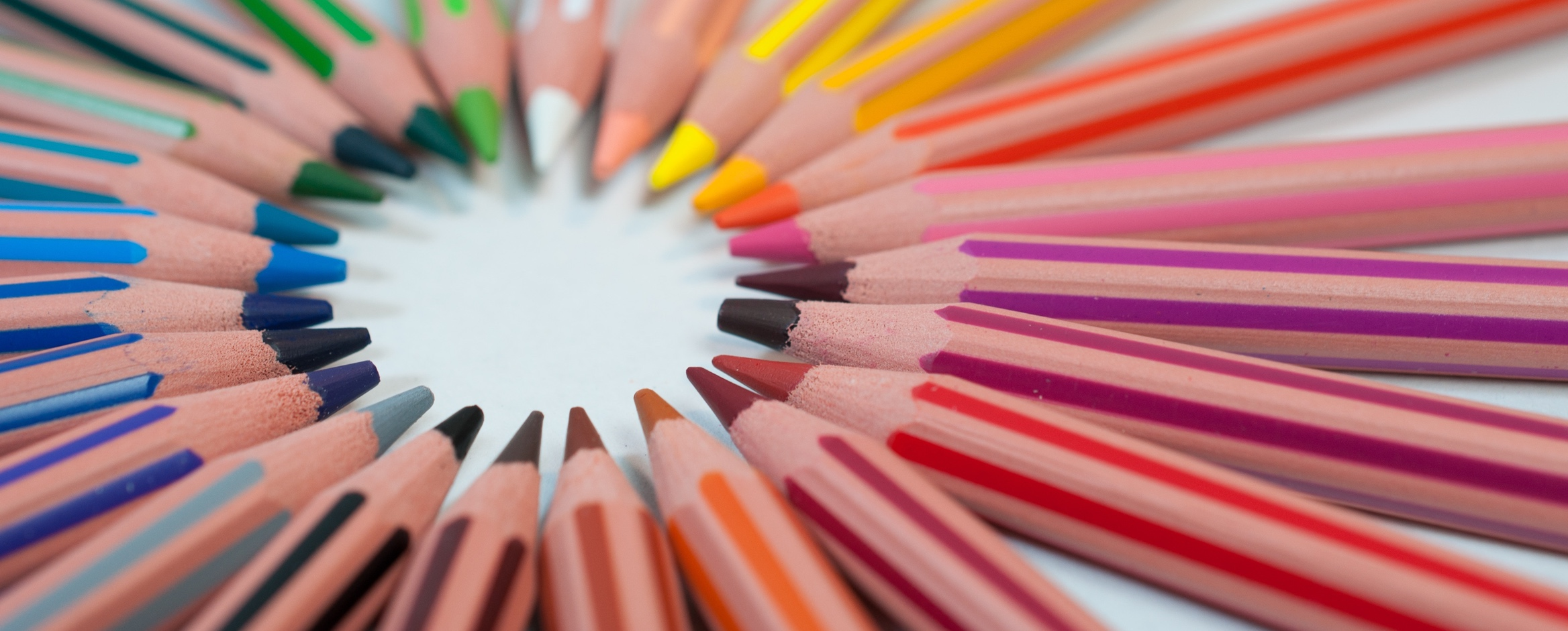 A circle of pencils, each a different shade