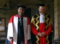 Chancellor Bill Bryson with George Alagiah