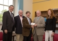 Graham Baker presenting cheque to IAS Directors