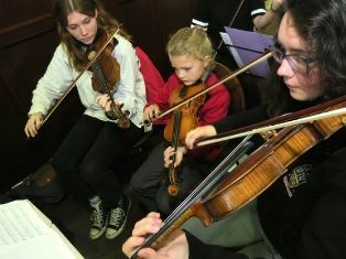 Student musicians perform new work written by school