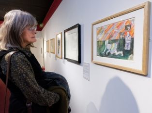 A woman views Untitled by Grayson Perry at Durham University Oriental Museum