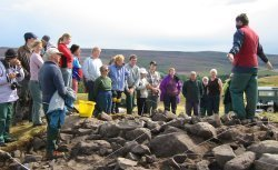 Peter Carne instructing group of volunteers on a community excavation in Northumberland