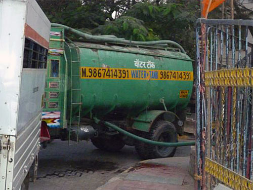 Private water tanker, Khotwadi - private water tankers supply water to many informal settlements and even formal residential localities in Mumbai and operate through mafia-style arrangements that flourish because of the water inequities in the city.