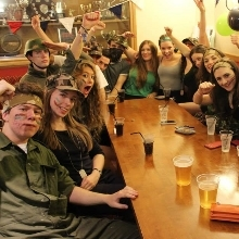 Students drinking and smiling in Grey Bar