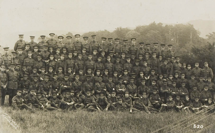 Image of Durham University Officers' Training Corps, Stobs camp, 1914. A company formal group, officers and cadets, in uniform. The photograph was taken by H. Hitchen of Northwich, and is within an album, one of four, created by Macfarlane-Grieve. (Ref: M