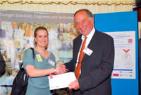 Victoria Christie, receives her commendation from Professor John Hedgers (Westminster University