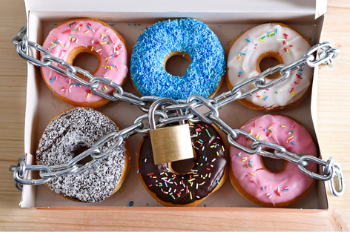 Box of donuts wrapped in a locked chain