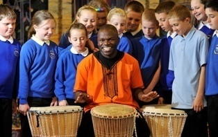 Peter Okeno Ong'are with local school children