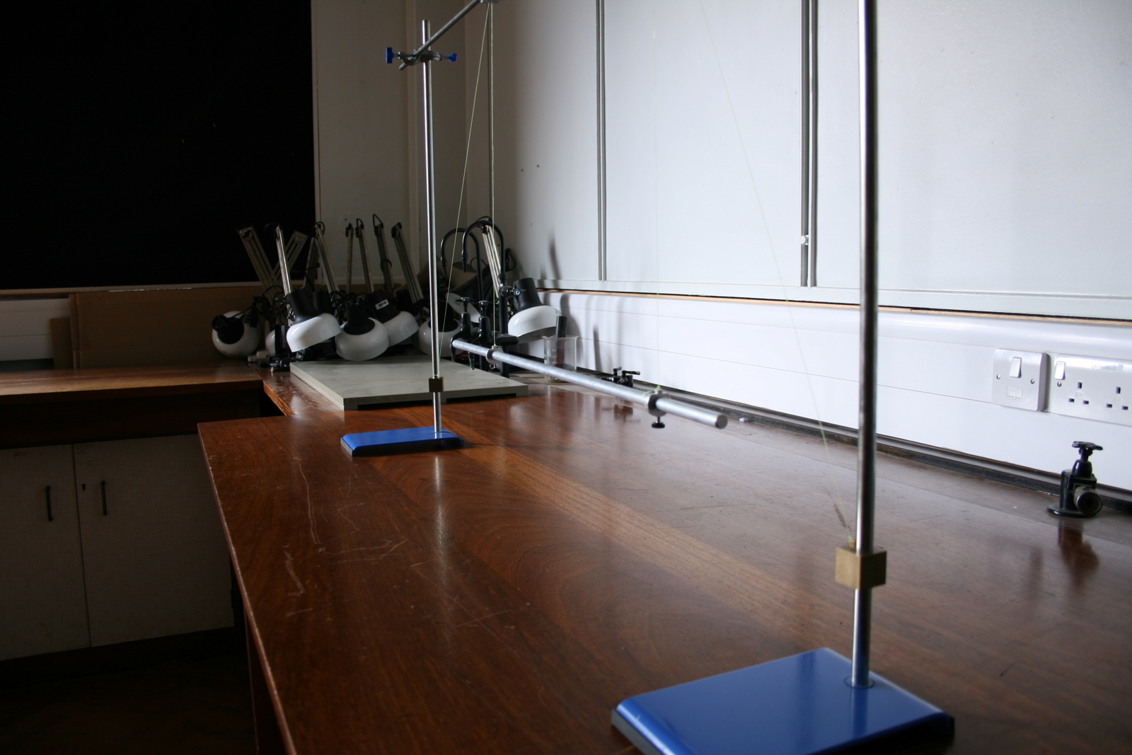physics bifilar pendulum A simple pendulum is composed of a weight, or bob, hanging freely from the end of a string or bar gravity pulls the bob in a downward arc, causing it to swing.
