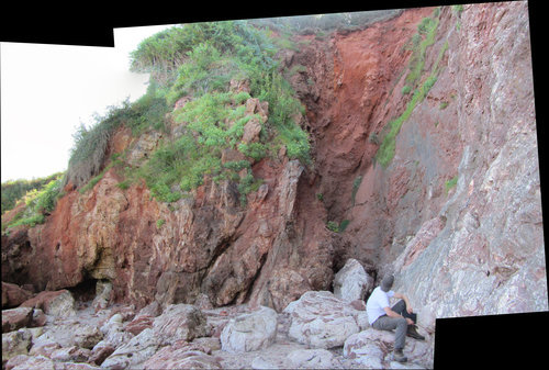 c.40m wide fracture cavity in Devonian limestone, filled with Permo-Triassic sediment and hydrothermal mineralisation