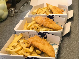 Fish and chips in take-away box