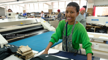 Smiling female worker in a clothing factory