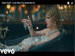 clip from Taylor Swift video - she is in a bath of diamonds