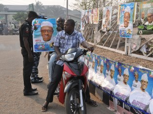 Men holding up an election poster in Nigeria 2015