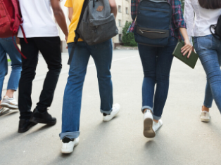 Anonymous group of male and female students walking