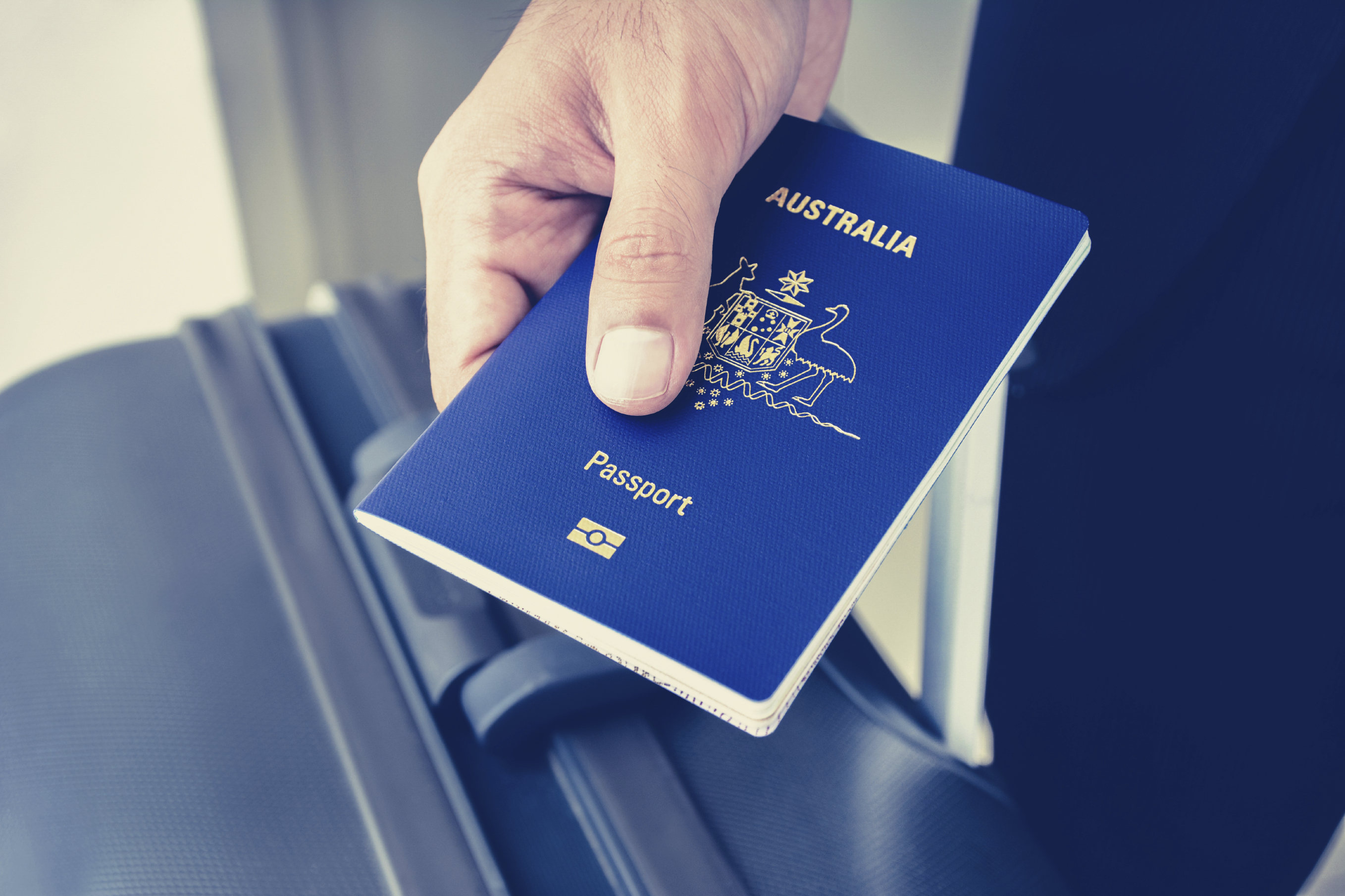 Image Of A Hand Holding An Australian Passport How To Apply