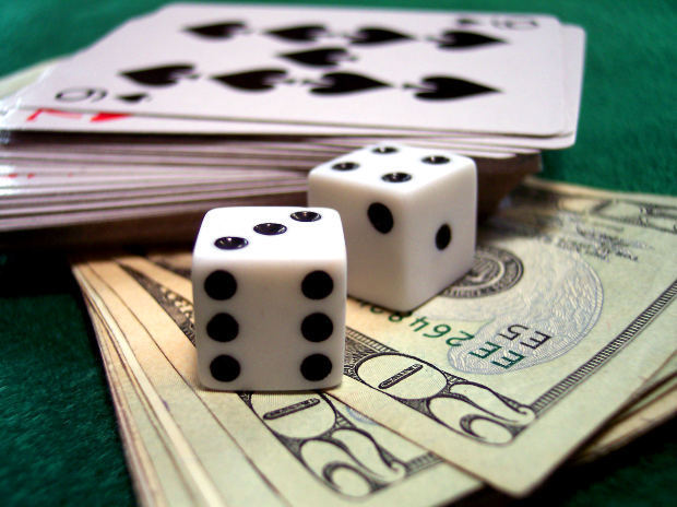 Picture of dice, money and playing cards