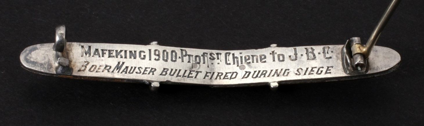 Image of bisected Mauser bullet (back) transformed into a brooch commemorating the siege of Mafeking