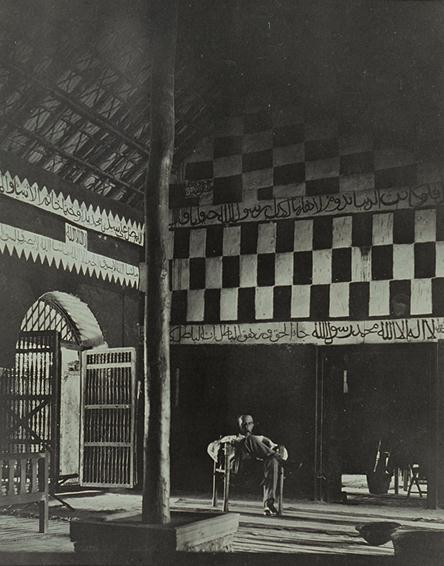 Image of H. A. MacMichael sitting in the throne room in 'Ali Dinar's palace, El Fasher, 1917 (Ref: SAD.588/1/69)